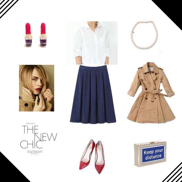 白のシャツにネイビーのスカートを合わせたコーデ