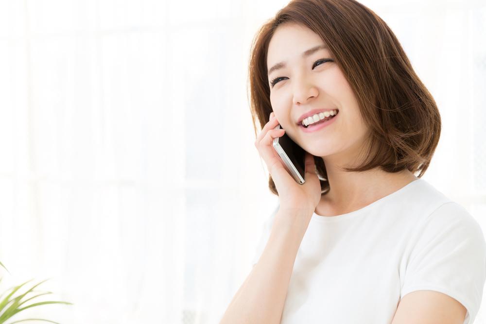 携帯電話と女性