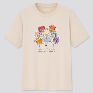 顔のある花と後ろ姿のアリスがプリントされたベージュTシャツ