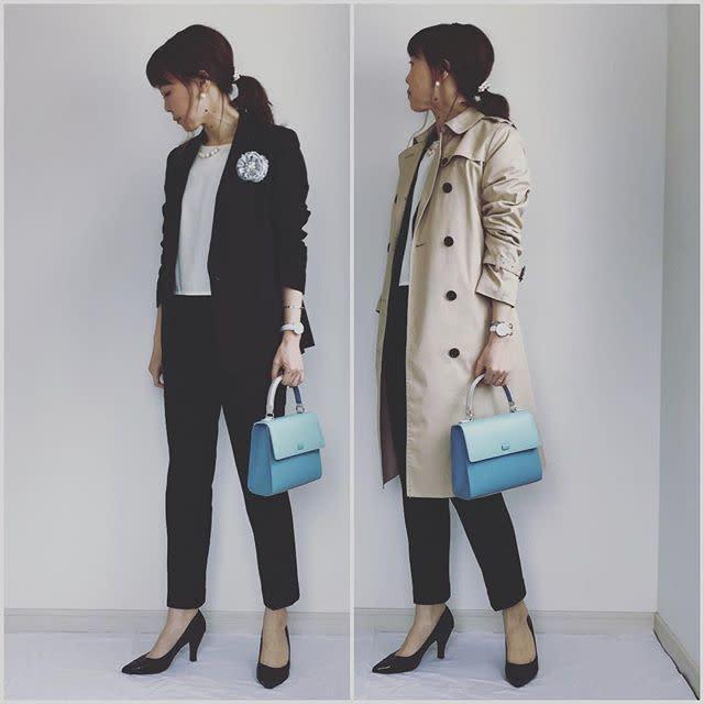 スーツにトレンチコートを着た女性