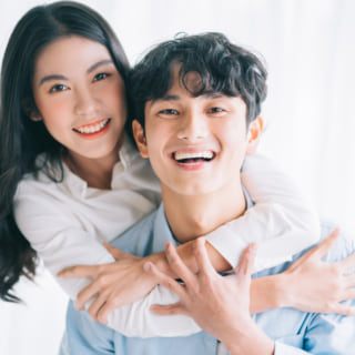 Asian couple happily embracing each other